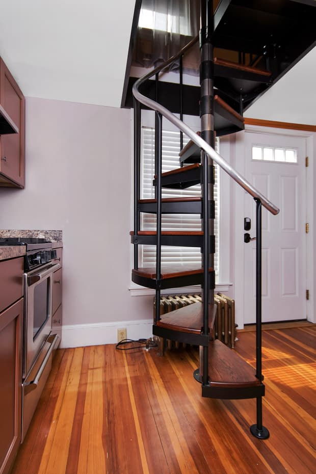 Classic steel with wood Spiral Staircase in a kitchen