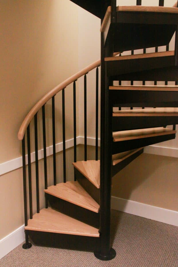 Classic steel with wood Spiral Staircase in a corner