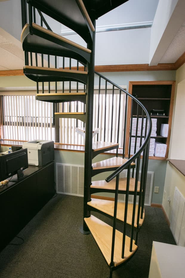 Classic steel with wood Spiral Staircase in an office