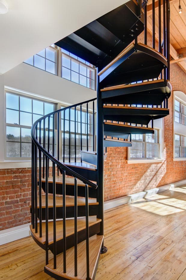 Classic steel with wood Spiral Staircase in a loft apartment