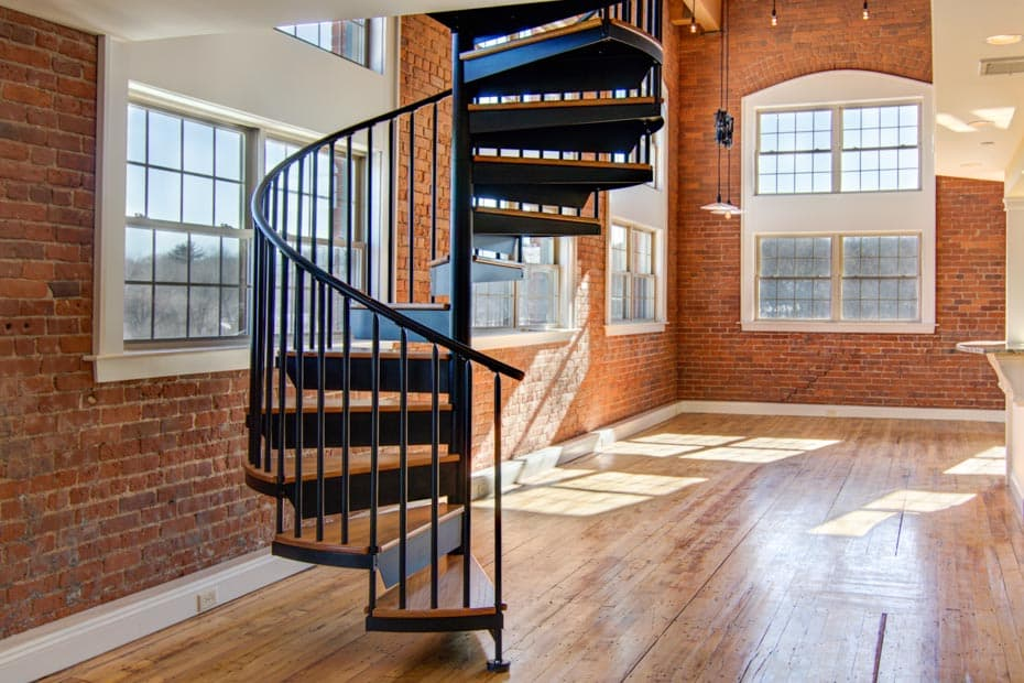 Classic steel with wood Spiral Staircase in urban loft