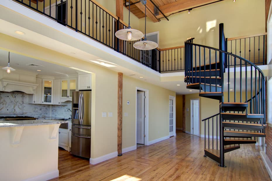 Classic steel with wood Spiral Staircase next to kitchen