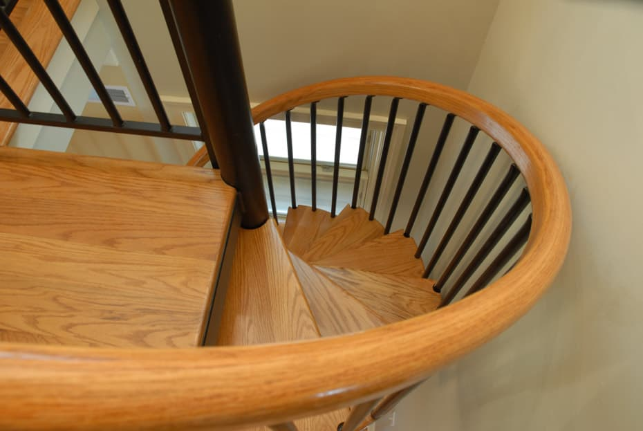 Classic steel with wood Spiral Staircase in home foryer
