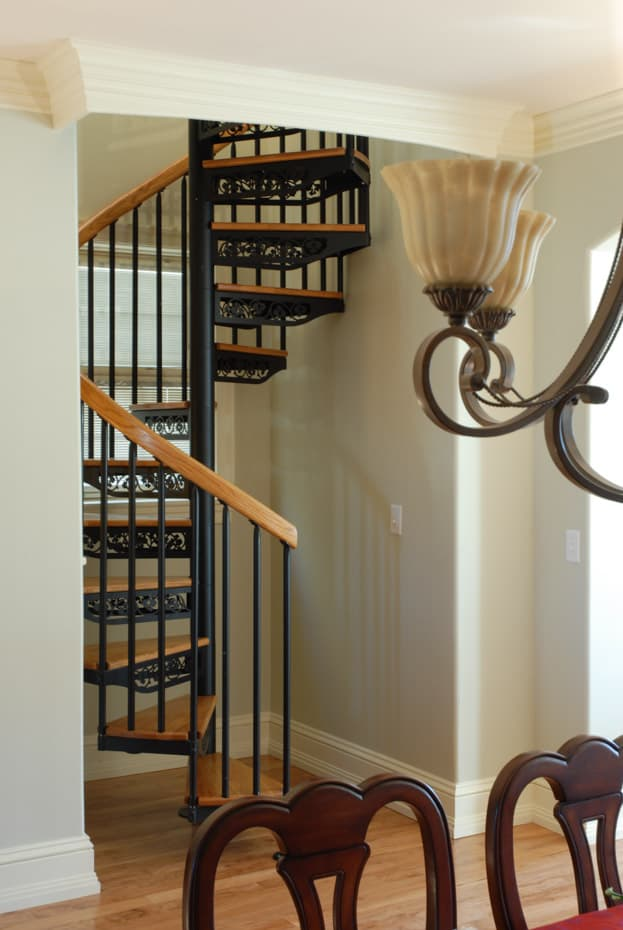 Classic steel with wood Spiral Staircase in traditional home