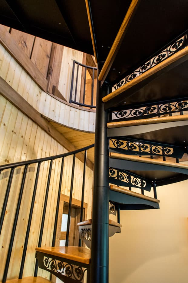 Classic steel with wood Spiral Staircase primary egress in home