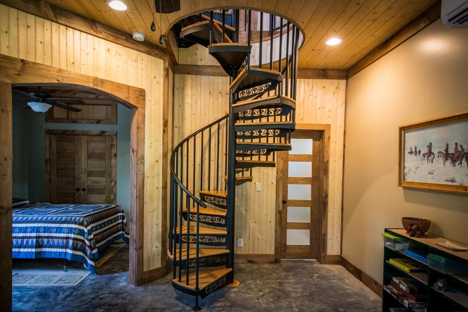 Classic steel with wood Spiral Staircase timberframe home