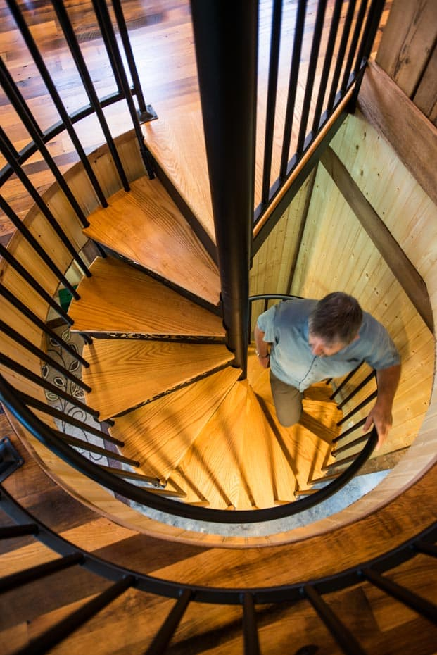 walking up a Classic steel with wood Spiral Staircase