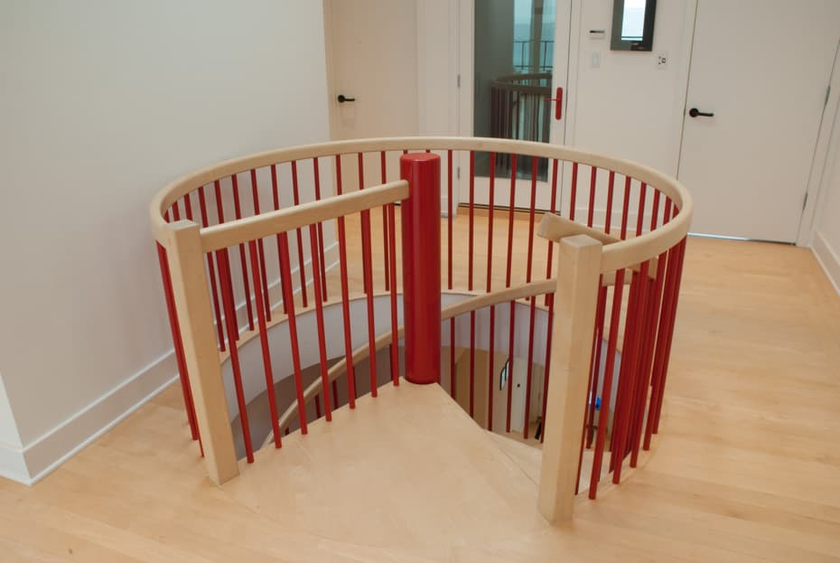 Classic steel with wood Spiral Staircase red enclosure rail