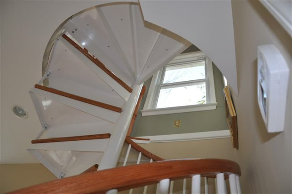 Classic steel with wood Spiral Staircase under tread view