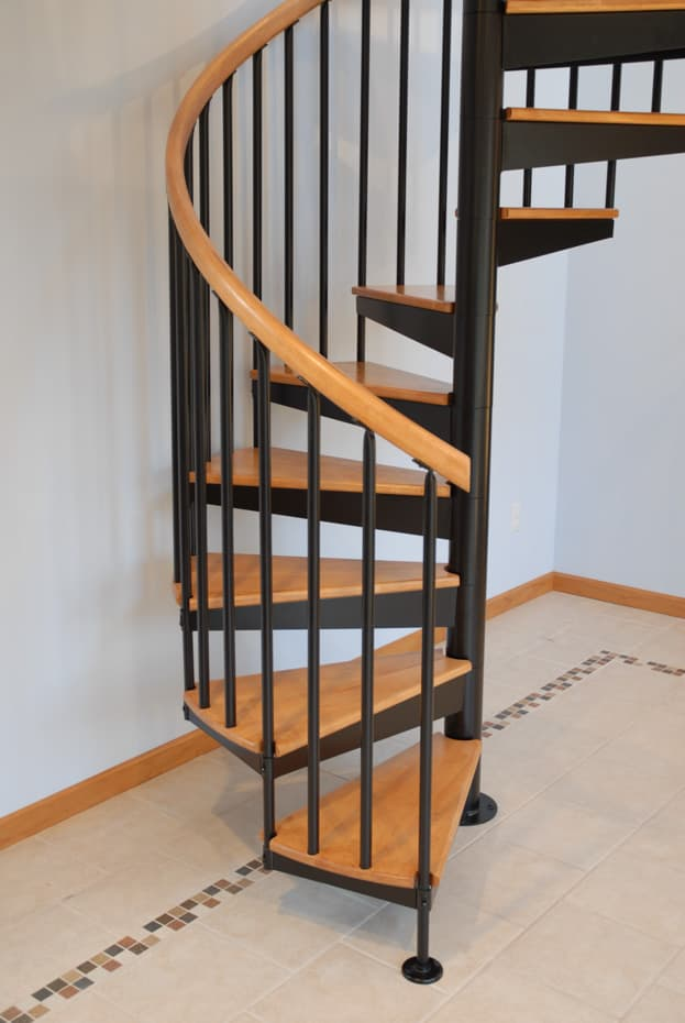 Classic steel with wood Spiral Staircase on tile flooring