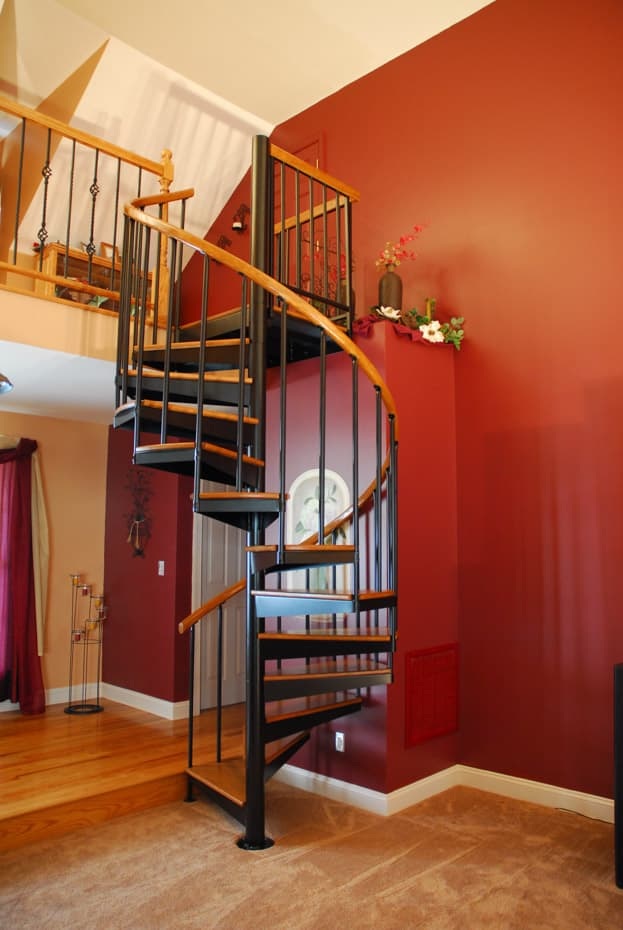 Classic steel with wood Spiral Staircase in elegant home