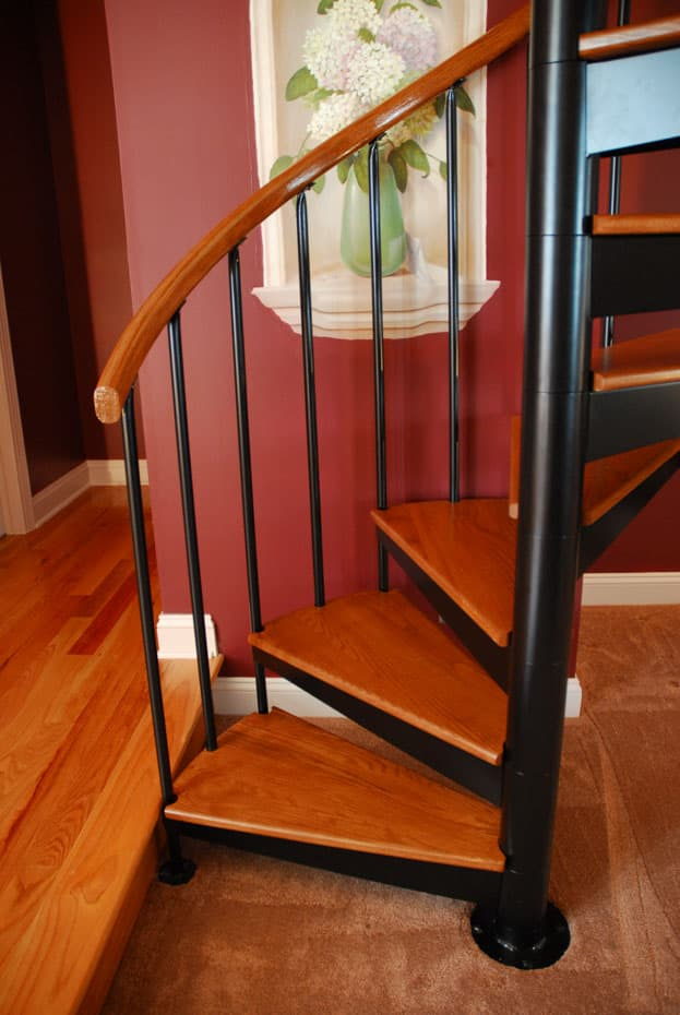 Classic steel with wood Spiral Staircase stained treads