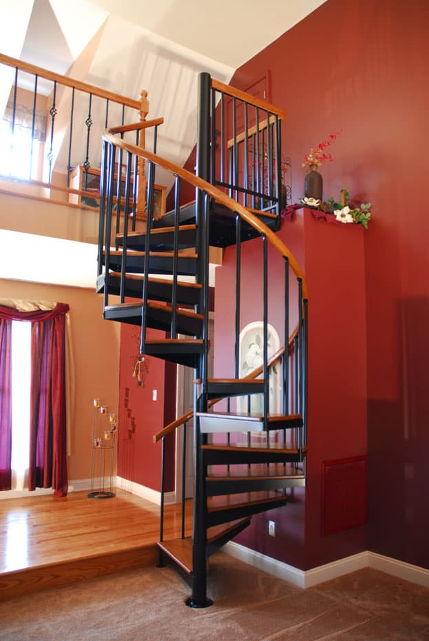 Classic steel with wood Spiral Staircase wood handrail