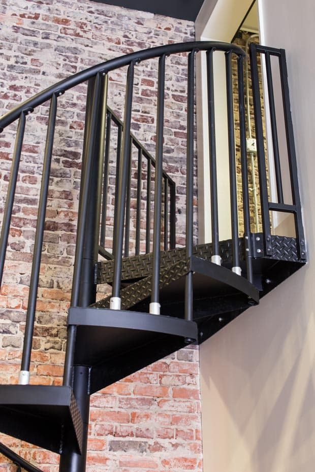 Commercial Spiral Staircase Bare Brick Industrial Look