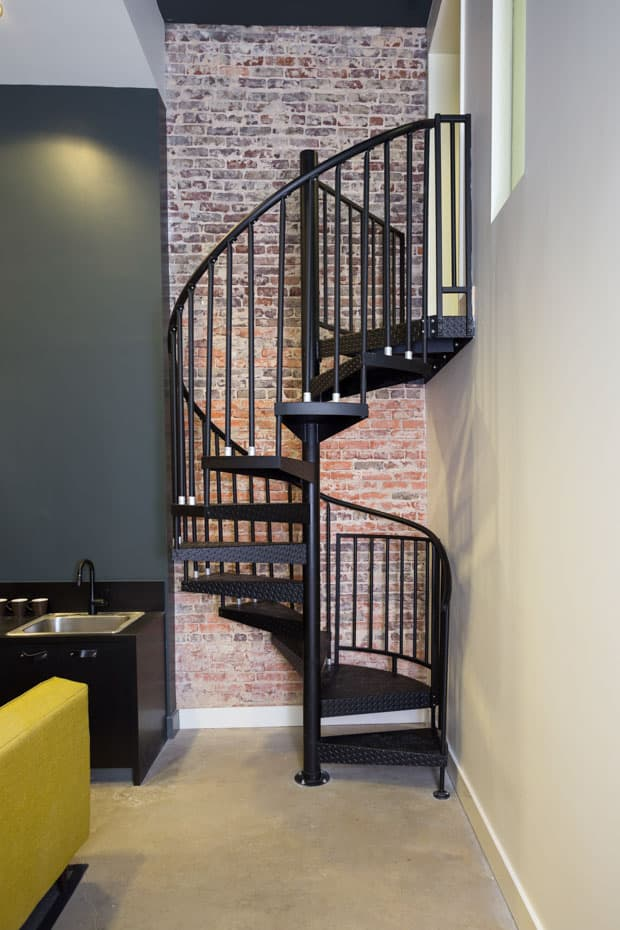 Commercial Spiral Staircase Brick Accent Wall