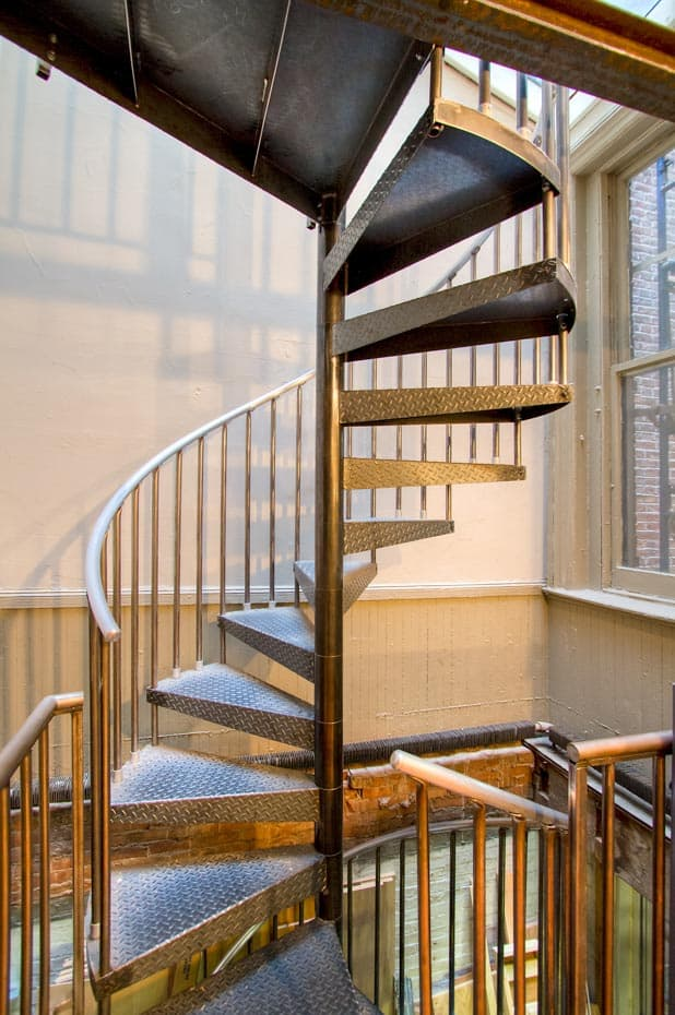 Commercial Spiral Staircase with continuous sleeves