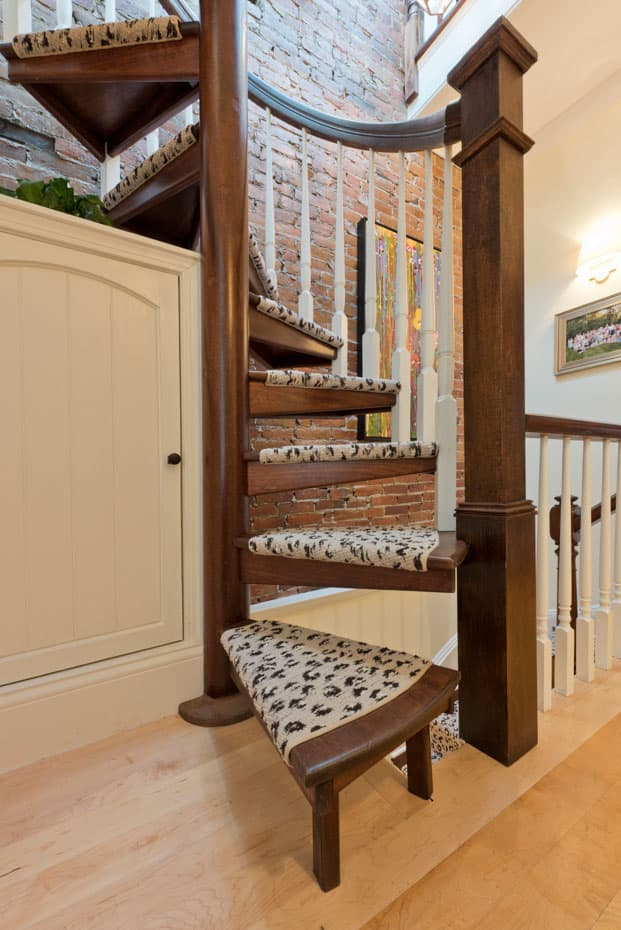 All wood Spiral Staircase carpeted treads