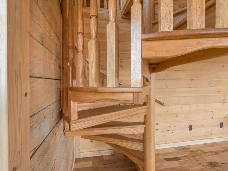 All wood Spiral Staircase encolsed tread end