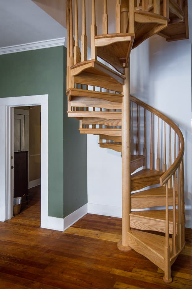 All wood Spiral Staircase farmhouse living room