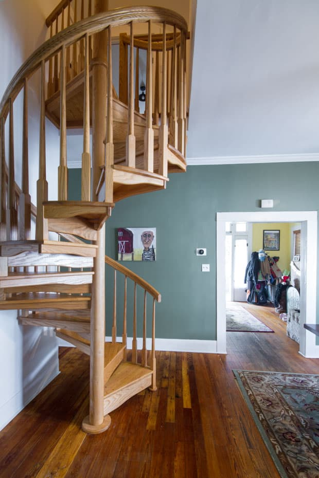 All wood Spiral Staircase home foyer