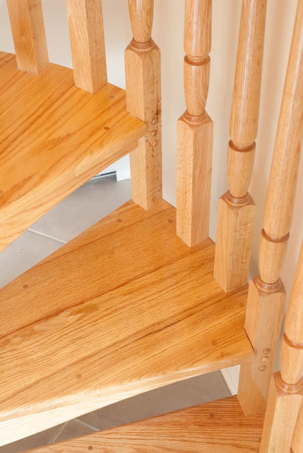 All wood Spiral Staircase baluster tread connection