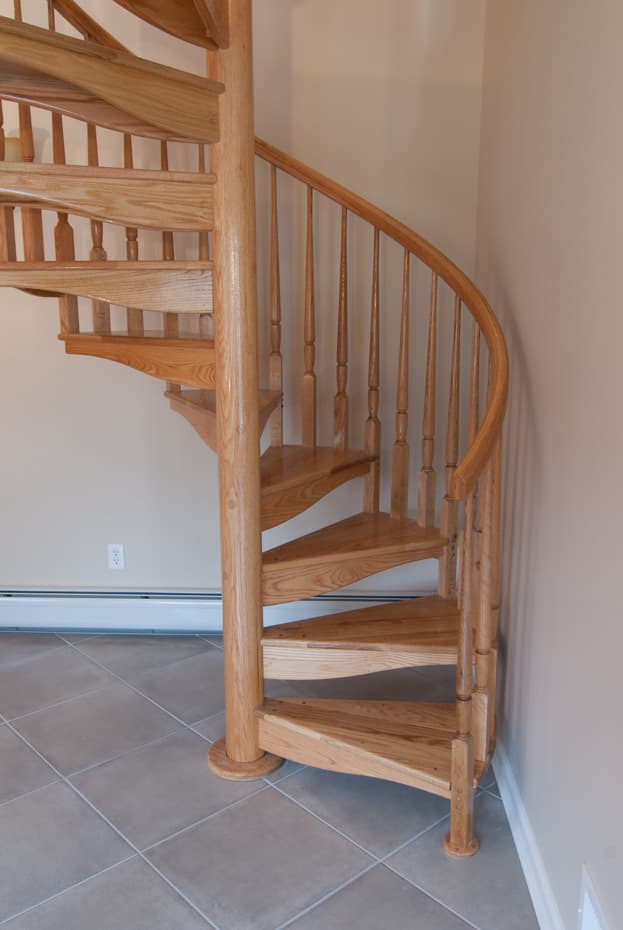 All wood Spiral Staircase tucked away in corner