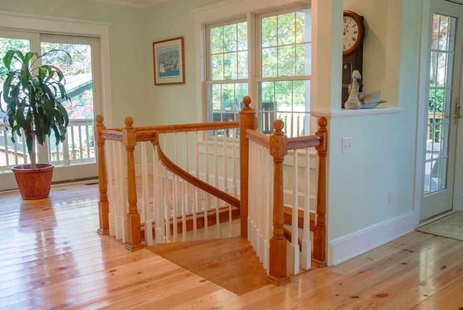All wood Spiral Staircase loft enclosure rail