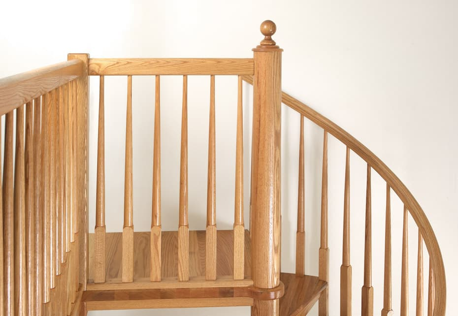 All wood Spiral Staircase platform railing