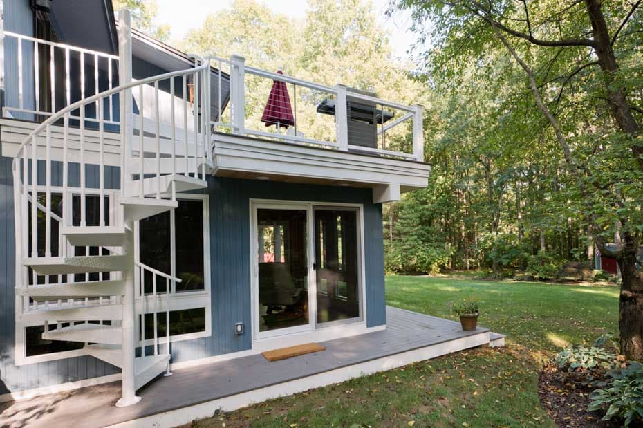 New England Home With White Deck Staircase