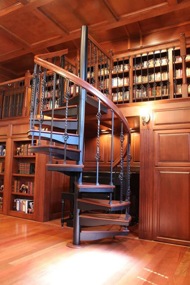 Forged Iron Spiral Staircase with a custom wood handrail