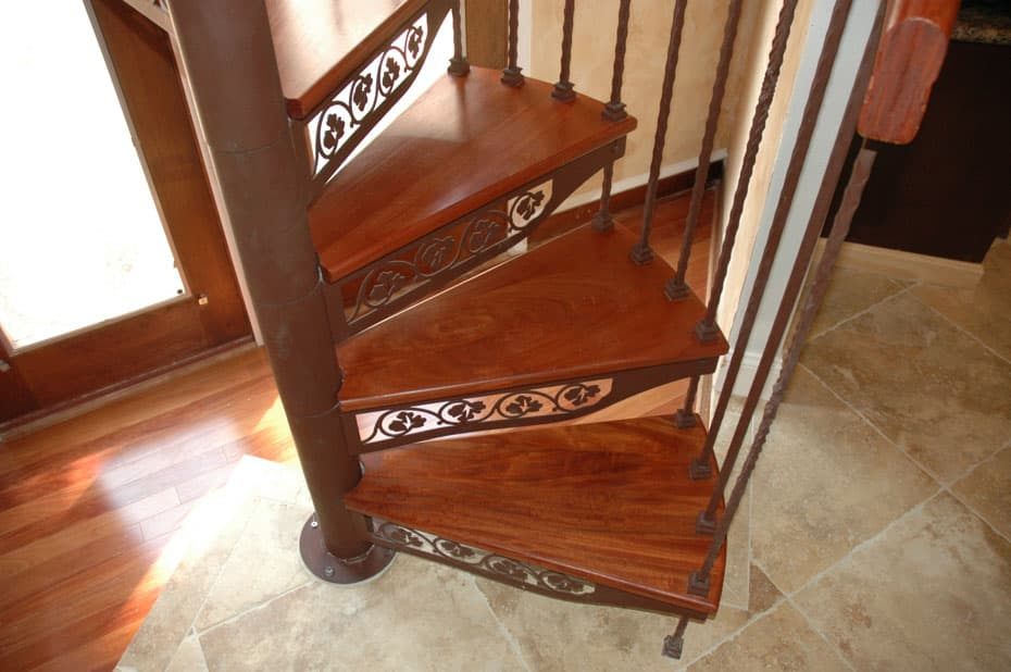 Forged Iron Spiral Staircase in traditional home