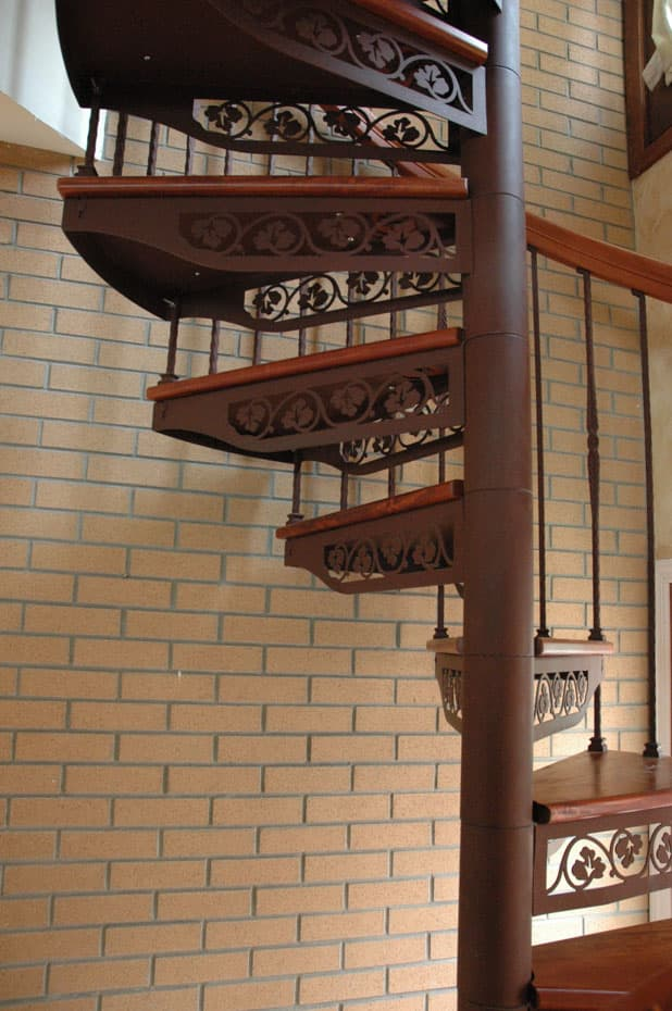 Forged Iron Spiral Staircase with ivy stencil treads