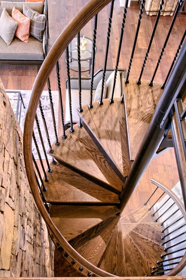 Forged Iron Spiral Staircase in a log cabin