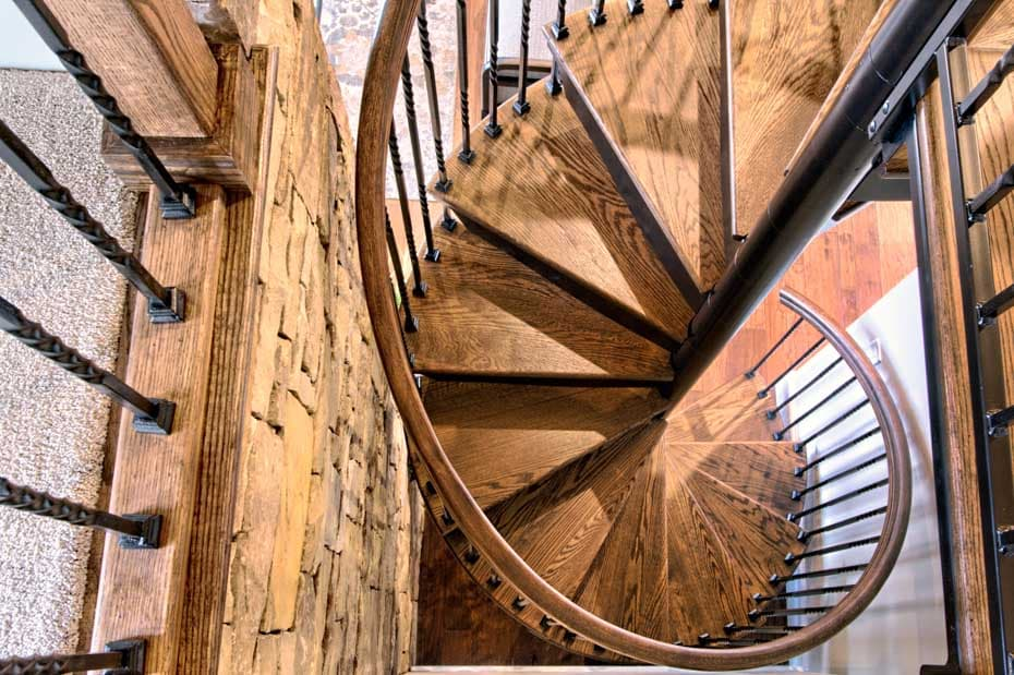 Forged Iron Spiral Staircase with rustic wood