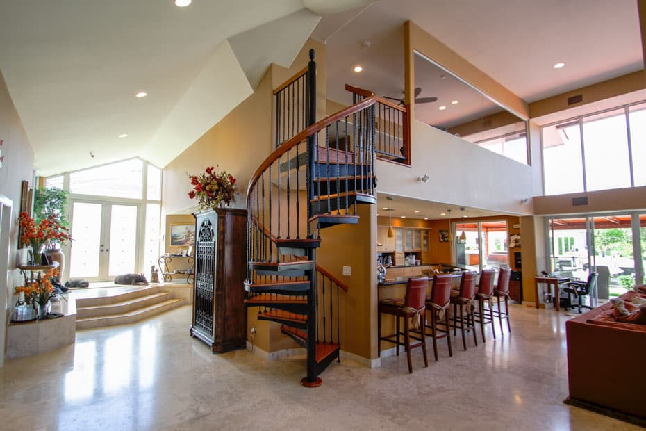 Forged Iron Spiral Staircase in home foyer