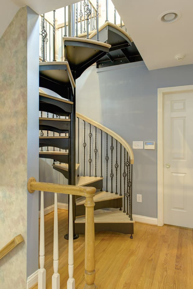 Forged Iron Spiral Staircase in a corner