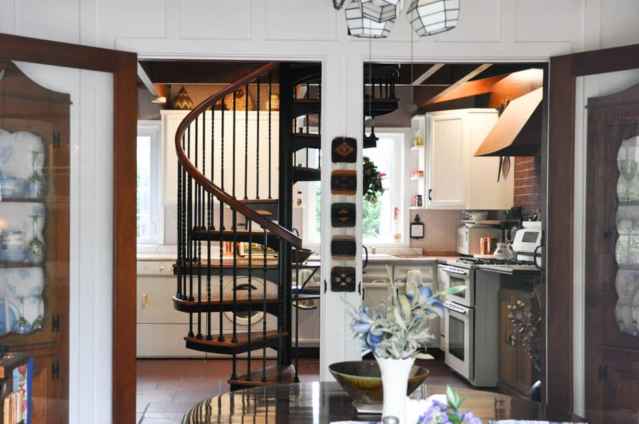Forged Iron Spiral Staircase in middle of a kitchen