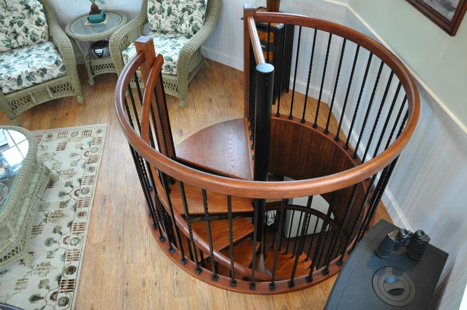Forged Iron Spiral Staircase with circular enclosure rail